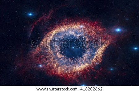 The Helix Nebula is a large planetary nebula located in the constellation Aquarius. Elements of this image furnished by NASA. - stock photo