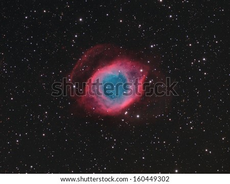 The Helix Nebula- This is a picture of the Helix Nebula, also known as the the Eye of God andNGC7293. It is a planetary nebula about 700 light years away in the constellation Aquarius. - stock photo