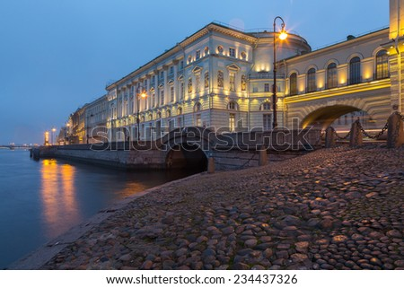 The Hermitage Theatre in Saint Petersburg, Russia is one of five Hermitage buildings lining the Palace Embankment of the Neva River. - stock photo