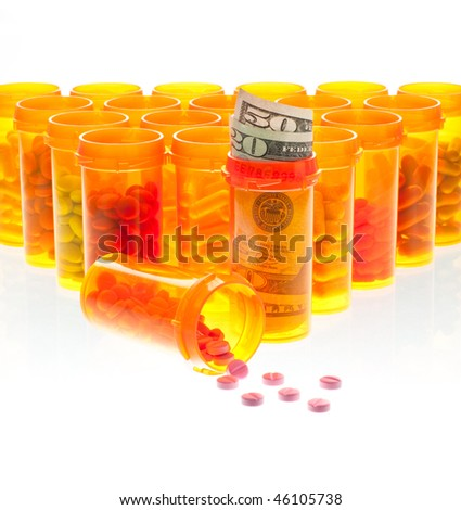 The High Cost of Health Care.  Pills and US Currency  in Pill Bottles Isolated on White. - stock photo