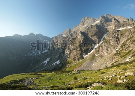 The high peaks of the Tatra Mountains in June morning. - stock photo