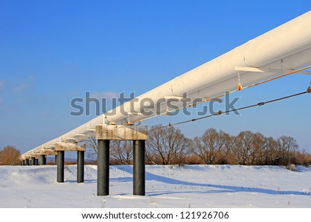 The high pressure pipeline in a winter landscape - stock photo