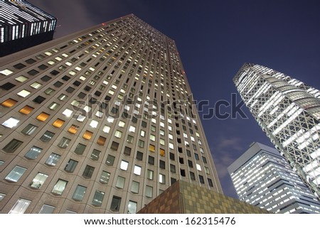 The high-rise buildings in Tokyo Japan at twilight  - stock photo