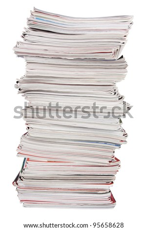 The high stack of old magazines on white background - stock photo