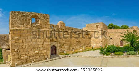 The high stone ramparts of the Small Fort of the Kasbah of El Kef, Tunisia.