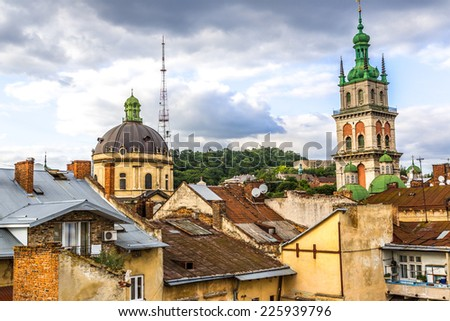 The high tower of The Assumption church among old roofs, Lviv, Ukraine.