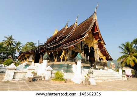 The highlight of the visit to the city of Luang Prabang is inevitable to visit Wat Xieng Thong, which is an important measure and is most beautiful. - stock photo