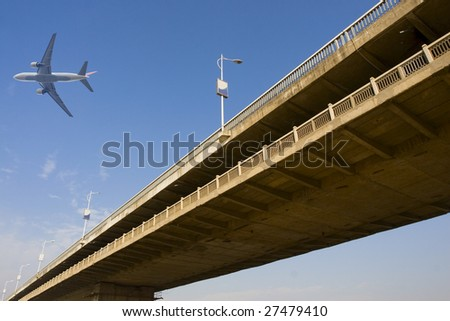 The highway bridge with a blue sky background. - stock photo