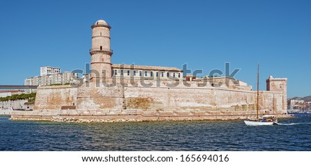 """The historic castle """"Saint Jean"""" at the harbor """"Vieux Port"""" of Marseille in South France - stock photo"""