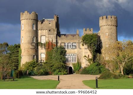 The historic Malahide Castle County Dublin, highlighted with clear Autumn light. - stock photo