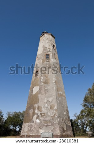 "The historic ""Old Baldy"" lighthouse on Bald Head Island North Carolina. - stock photo"
