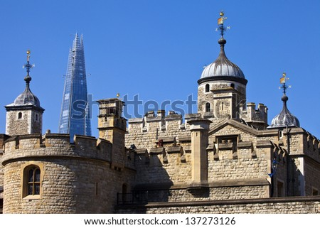 The historic Tower of London with the Shard in the background. - stock photo