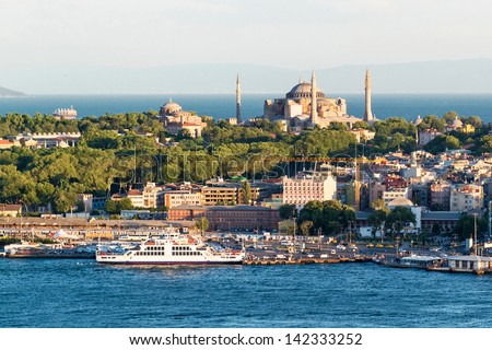 The historical center of Istanbul. Hagia Sophia on the background of the Sea of Marmara. The view from the other side of the Golden Horn. - stock photo