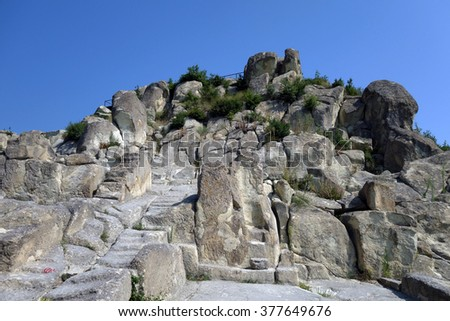 The historical complex Perperikon - ancient city built in South Bulgaria, Eastern Rhodopes, next to the city of Kardzhali. The throne carved in the rocks, on which the ruler of the temple sat.