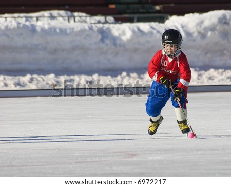 The hockey player attacks. - stock photo