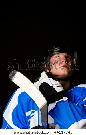 The hockey player holding his stick - stock photo