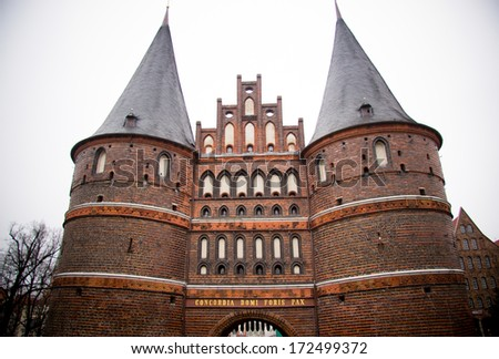 The Holstentor is a late Brick Gothic city gate in Lubeck - stock photo