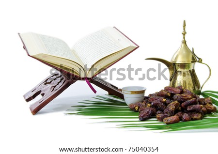 The Holy Quran Dates Fruits with Arabic Coffee Pot - stock photo