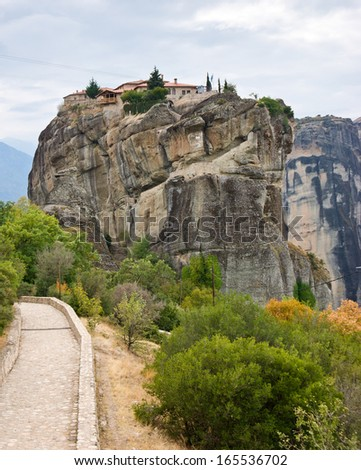 The Holy Trinity Monastery is difficult to get, because of no comfortable way, only steps to the top of the rock, Meteora, Greece. - stock photo
