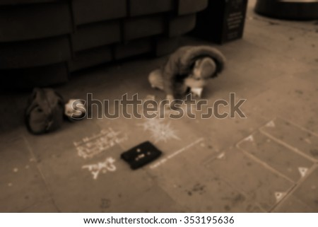The homeless man painting the street floor with chalk color paint ion sepia scene represent the people concept related idea.