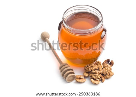 the honey in a jar and walnuts - stock photo