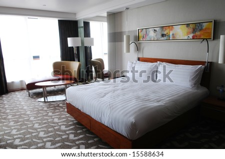 The hotel bedroom with a double bed.