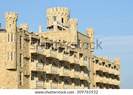 The hotel in the form of the lock revetted with the Dagestan stone. Hotel complex near Golubitskaya's village. - stock photo