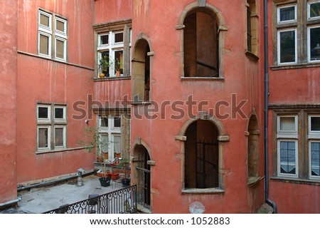 """The Hotel """"Tour Rose"""" has a beautiful tour rose (pink tower) in the inner courtyard called """"traboule"""". it is a typical architecture of the XVI century in Lyon. - stock photo"""