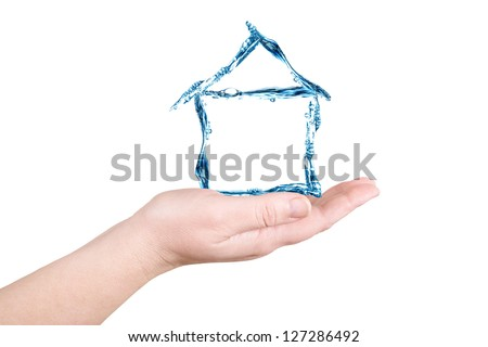 The house and water on a palm on a white background - stock photo