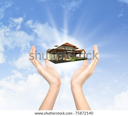 The house in human hand - stock photo