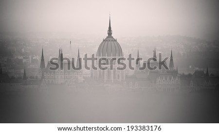 The house of hungarian parliament building in foggy weather, Budapest, Hungary - stock photo