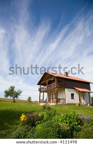 The house with a garden in the foreground - stock photo