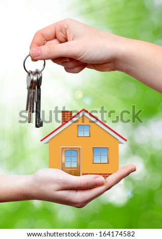The house with key in the hands  - stock photo