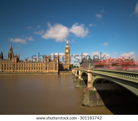 The Houses of Parliament during the day from across the River Thames. Traffic can be seen on Westminster Bridge - stock photo