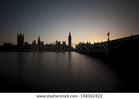 The Houses of Parliament in London over the river Thames at dusk