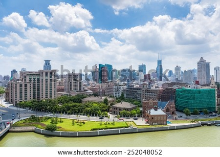 the huangpu district of shanghai against a sunny sky by suzhou riverside - stock photo