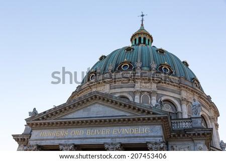 The huge Marmorkirken, The Marble Church, in Copenhagen is a popular tourist attraction in Denmark. - stock photo