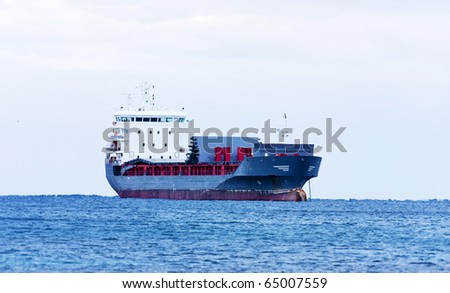 The huge ship waiting for landing - stock photo