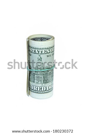 The hundred dollar bills folded in a roll isolated