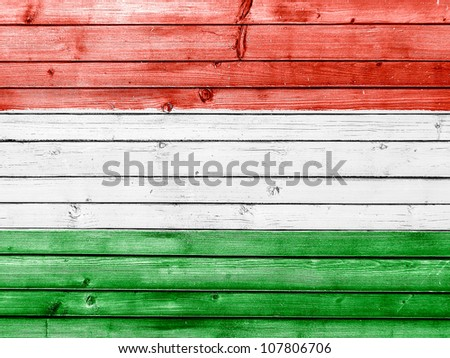 The Hungarian flag painted on wooden fence - stock photo