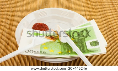 The hunger for money, 100 euros napkins, ketchup, plastic fork and knife