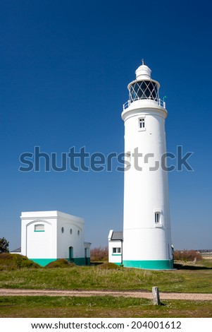 The 1867 Hurst Point Lighthouse near Milford-on-sea is located at Hurst Point in the county of Hampshire, and guides vessels through the western approaches to the Solent. England UK Europe