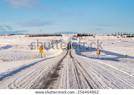 The Icelandic Winter Road with a Narrow Bridge - stock photo