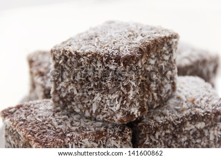 The iconic Australian cake the lamington made with chocolate and coconut. - stock photo
