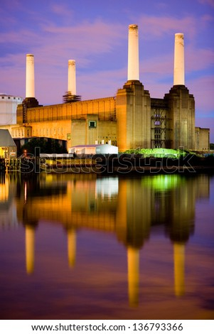 The iconic Battersea Power Station viewed from Pimlico in London at twilight. Long exposure, purple sky and the river thames.