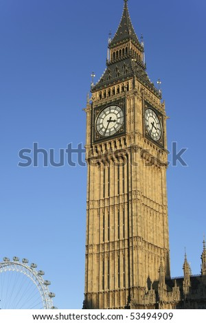 the iconic great four faced clock tower of the houses of parliament in westminster, central london - stock photo