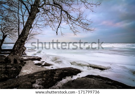 The icy and cold rocky shore of Lake Erie In Northwest Ohio.  - stock photo