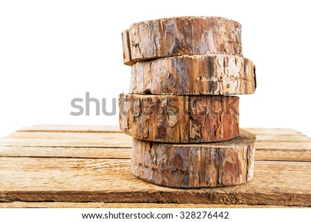 the idea of eco-friendly materials, pieces of pine wood stacked in a pile on a white background - stock photo