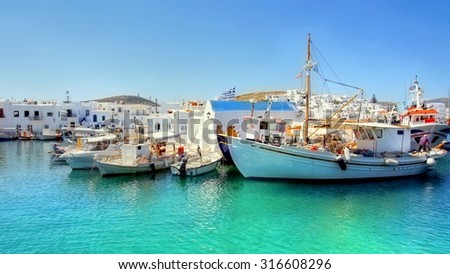 The idyllic harbor of the  quiet fishing village Naoussa on the Cyclades Island of Paros - stock photo