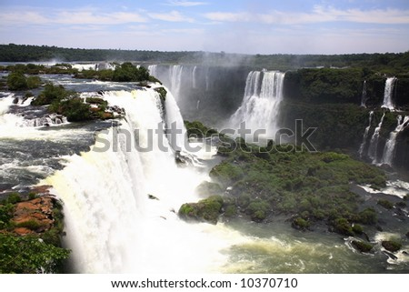 The Iguassu Falls is one of the largest masses of fresh water on the planet and divides, in South America, Brazil, Paraguay and Argentina. - stock photo